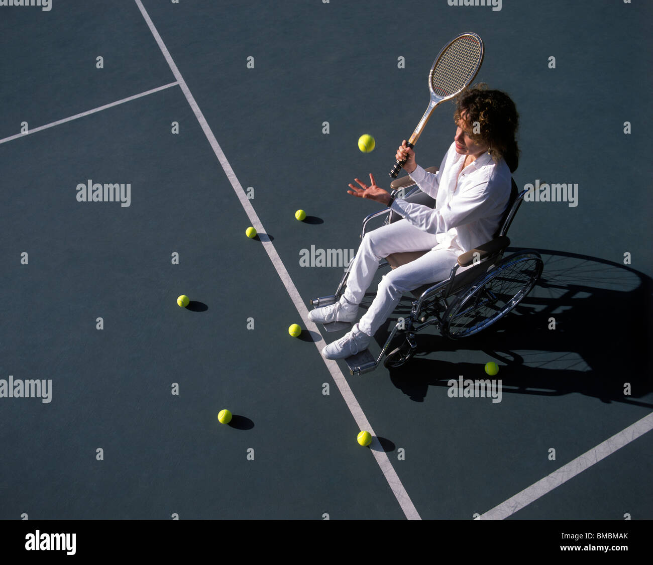 Woman on Tennis Court in Wheelchair - Stock Image