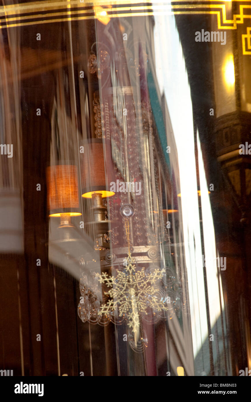 Shop window reflections on Church Street Station,  a mixed use entertainment area in downtown Orlando, Florida, - Stock Image