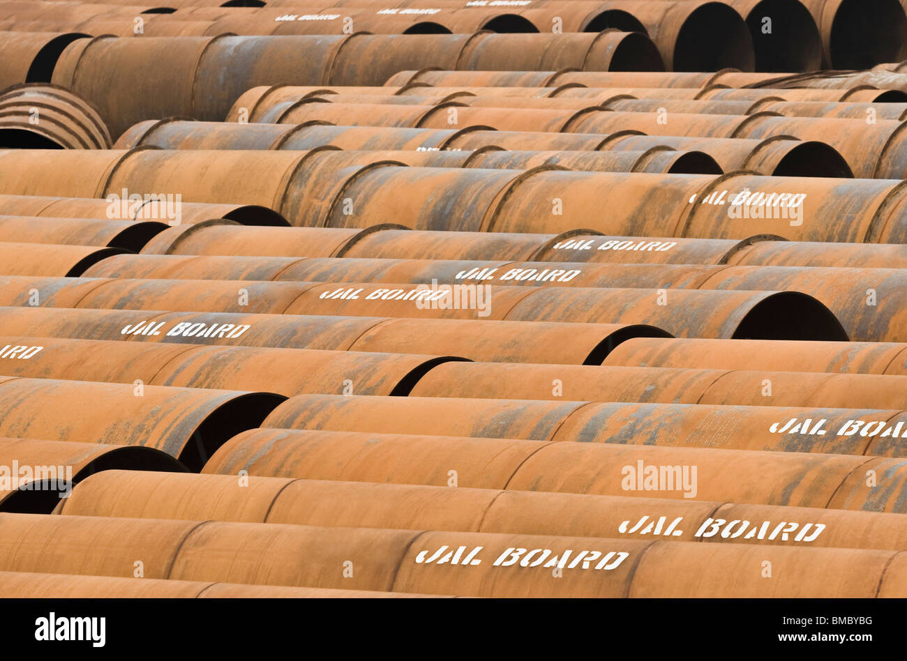 Rusty sewage pipes in a row, Delhi, India - Stock Image