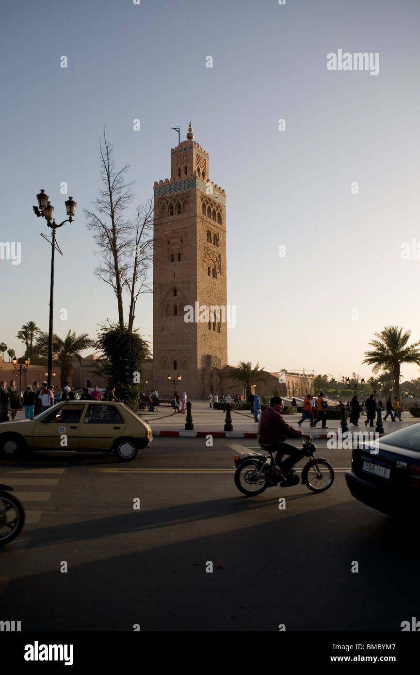 Busy road in front of Koutoubia Mosque , Marrakesh , Morocco , North Africa - Stock Image