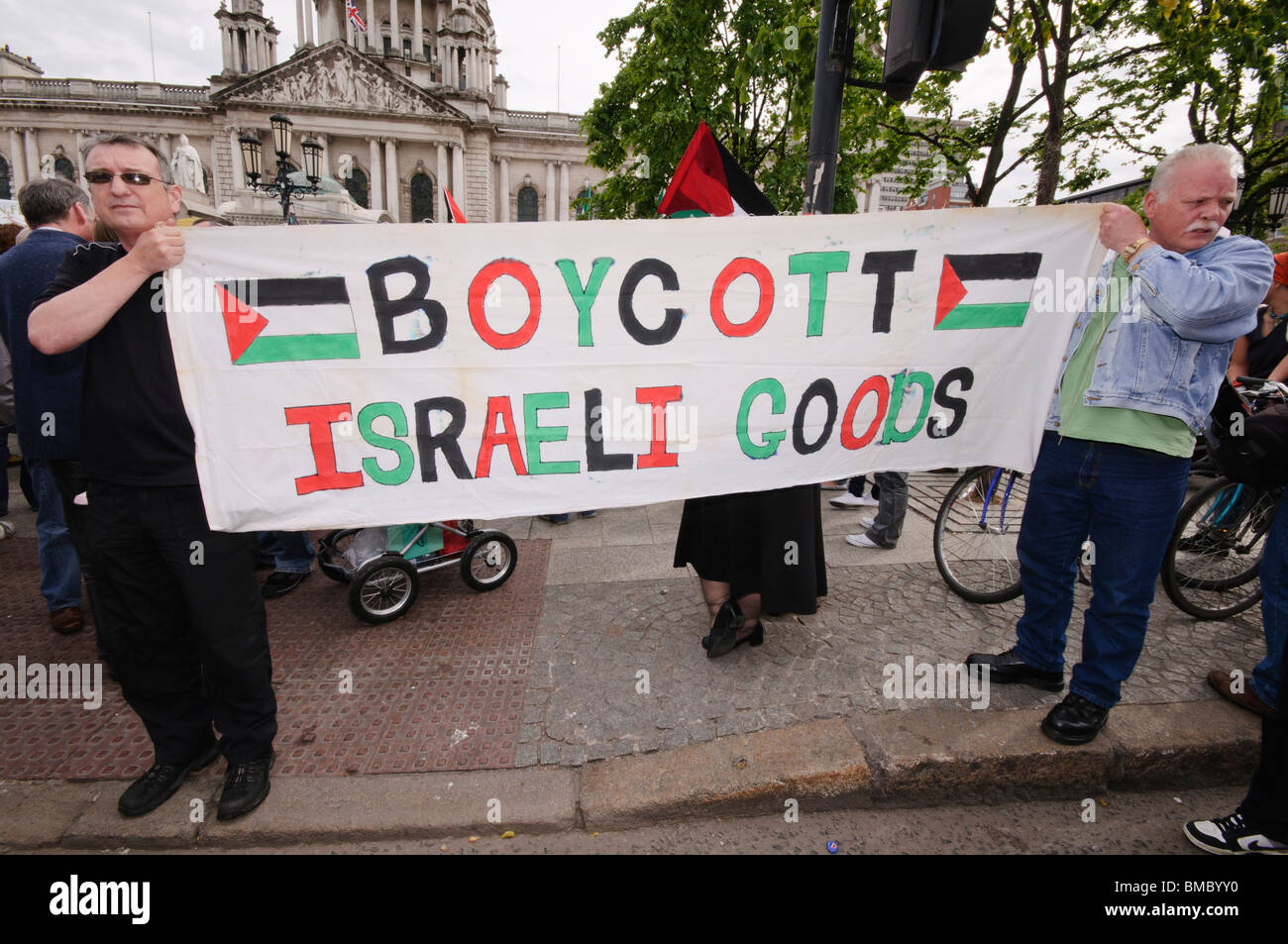 Protesters hold up a sign saying 'Boycott Israeli Goods' - Stock Image