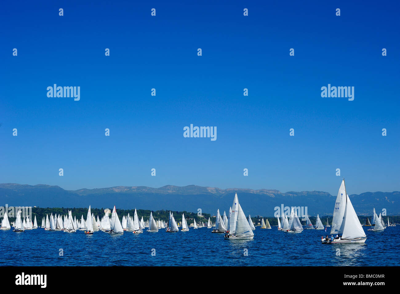 The start of the Bol d'Or yacht race on lac Leman (Lake Geneva) 2009 with the Jura mountains in the background. - Stock Image