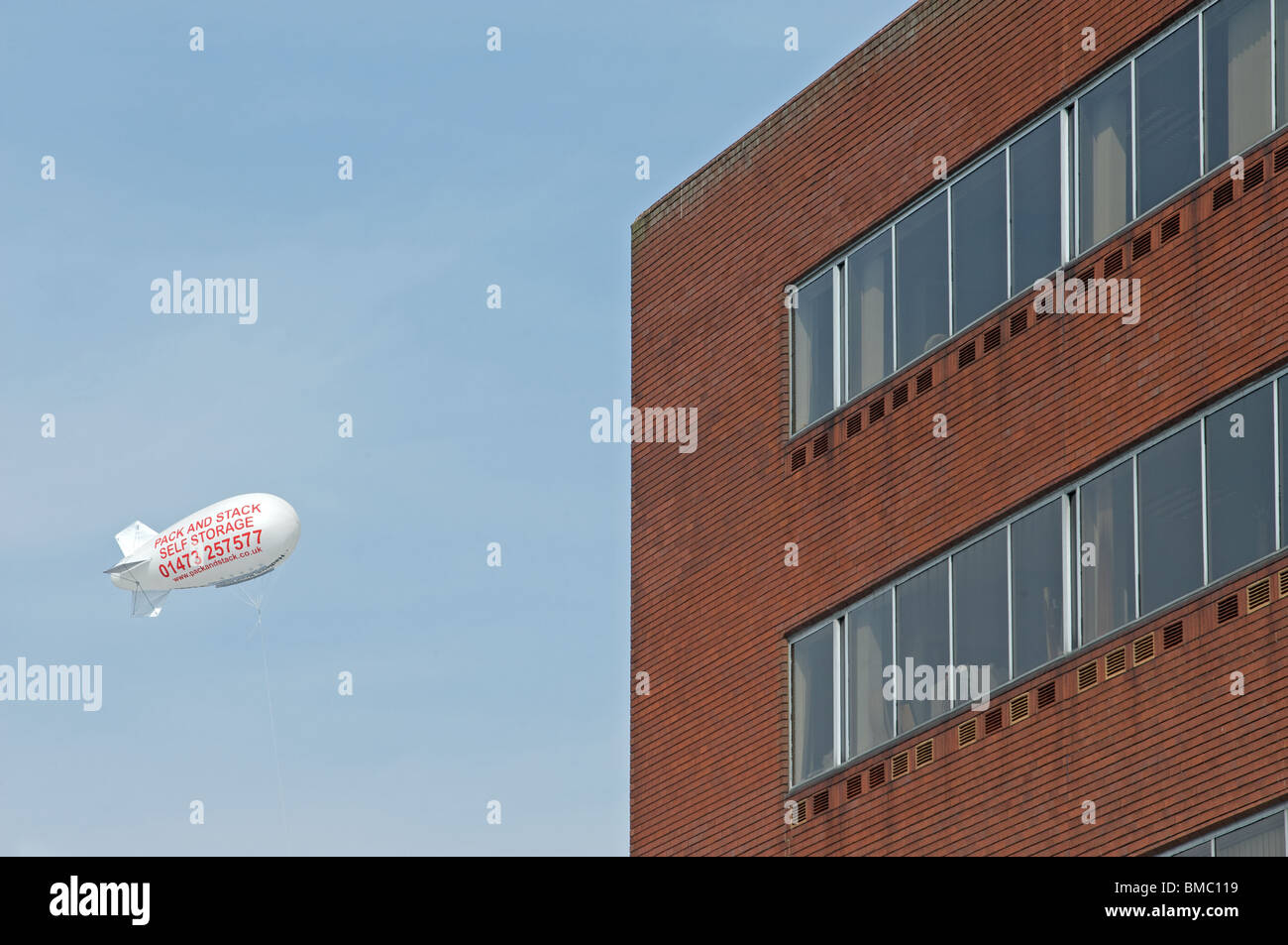 Advertising blimp for Pack and Stack, a self storage company - Stock Image