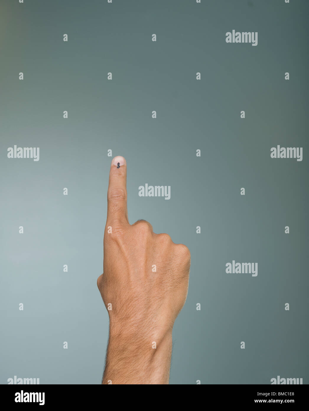 Close-up of a man's hand showing voting ink mark on his index finger Stock Photo