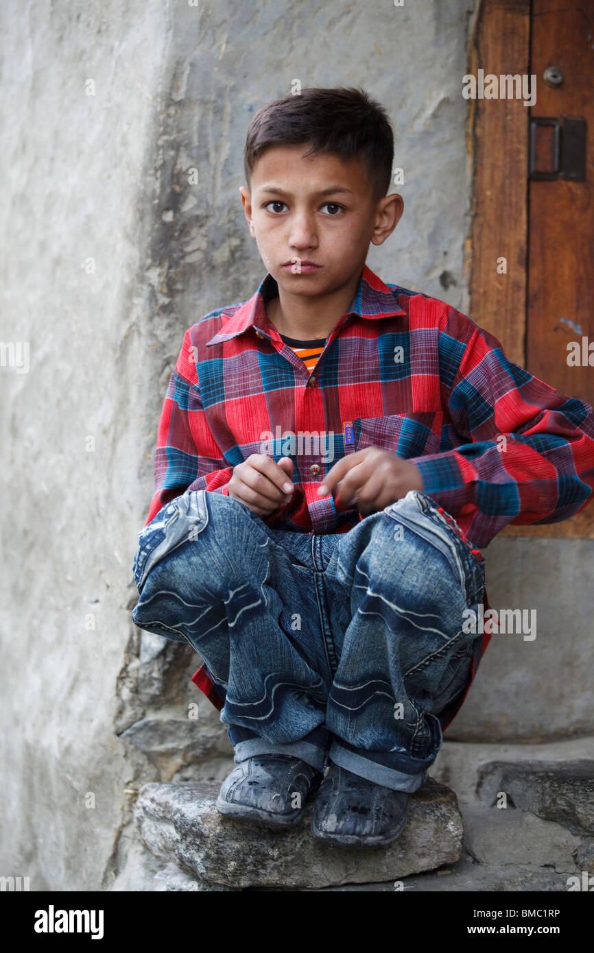 Boy in Doorway, Karimabad, Hunza, Pakistan - Stock Image