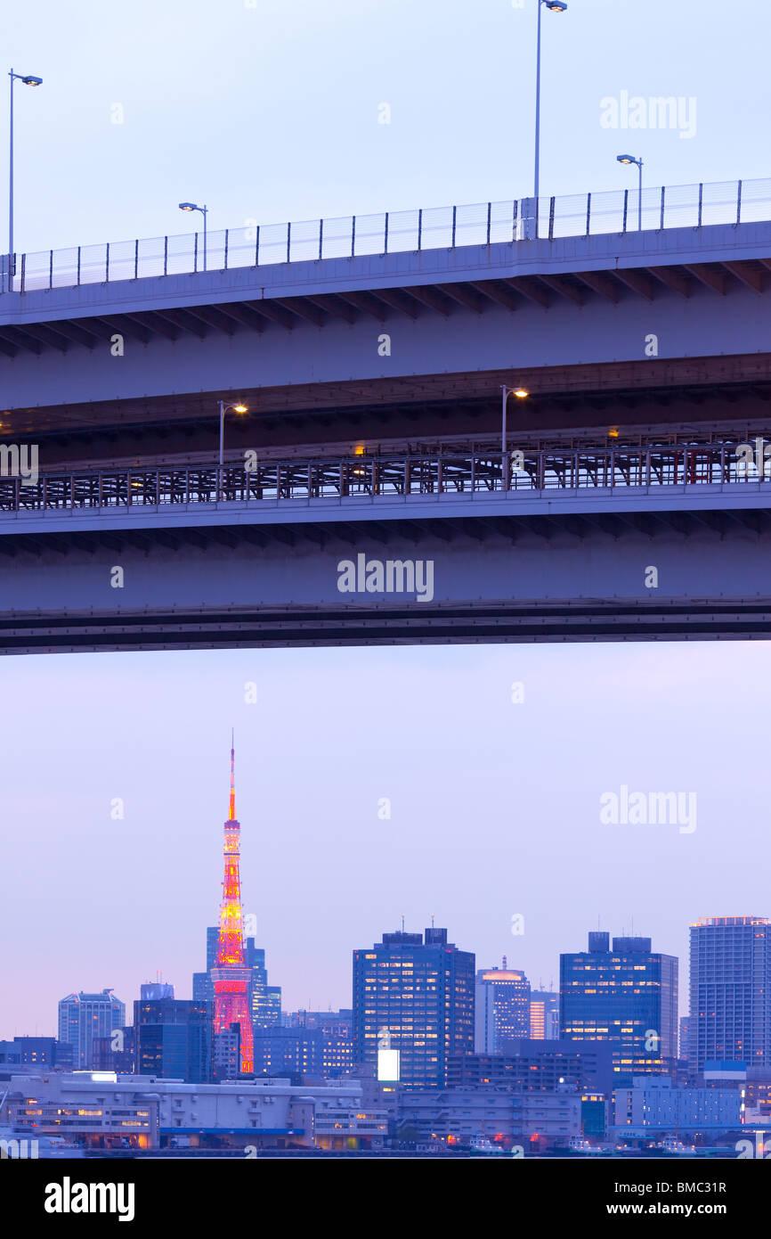 City skyline with Tokyo Tower and Rainbow Bridge, Tokyo, Kanto Region, Honshu, Japan - Stock Image