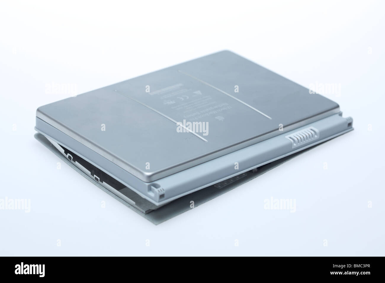 Damaged Macbook Pro laptop battery - Stock Image