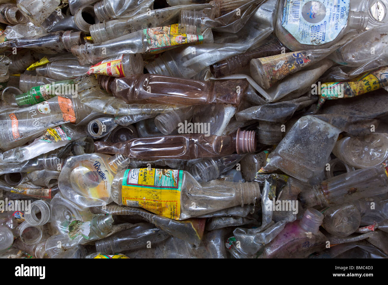 Crushed plastic bottle waste at a waste recycling plant - Stock Image