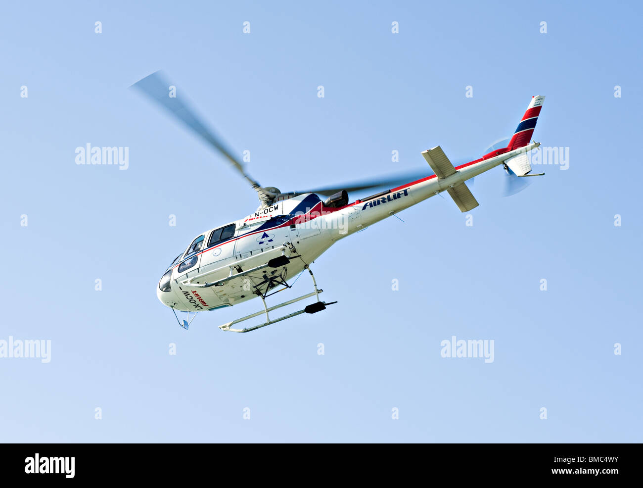 Airlift Helicopter AS Eurocopter 350B LN-OCW Taking Off in Clear Skies in Balestrand Sognefjord Sogn Norway - Stock Image