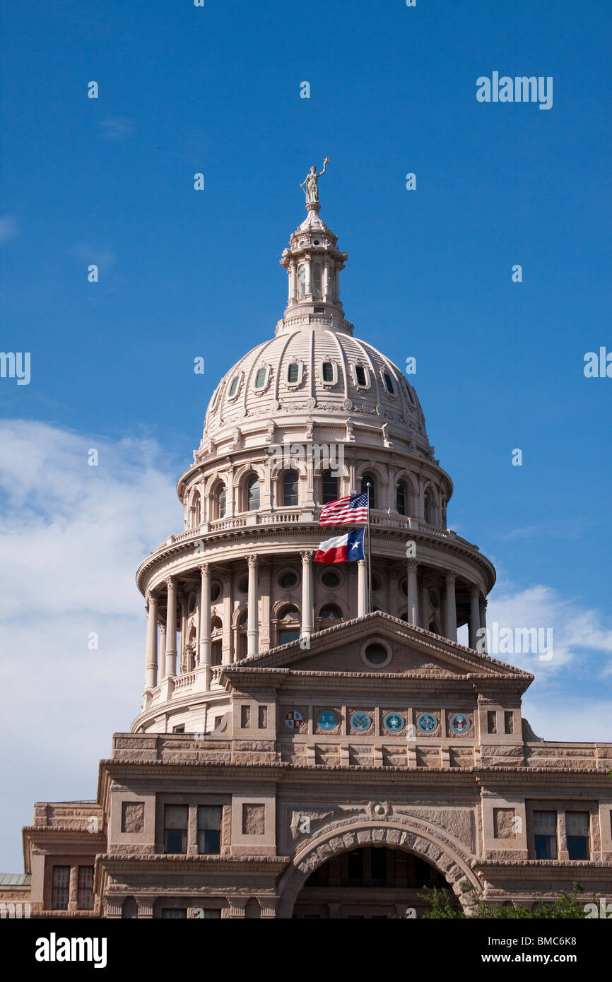 Dome of Texas state capitol building or statehouse in Austin with Texas and United States flags Stock Photo