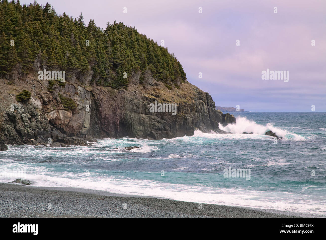 Surf pounding in on the stony beach of Middle Cove, Newfoundland, Canada.  North of St. John's. Stock Photo