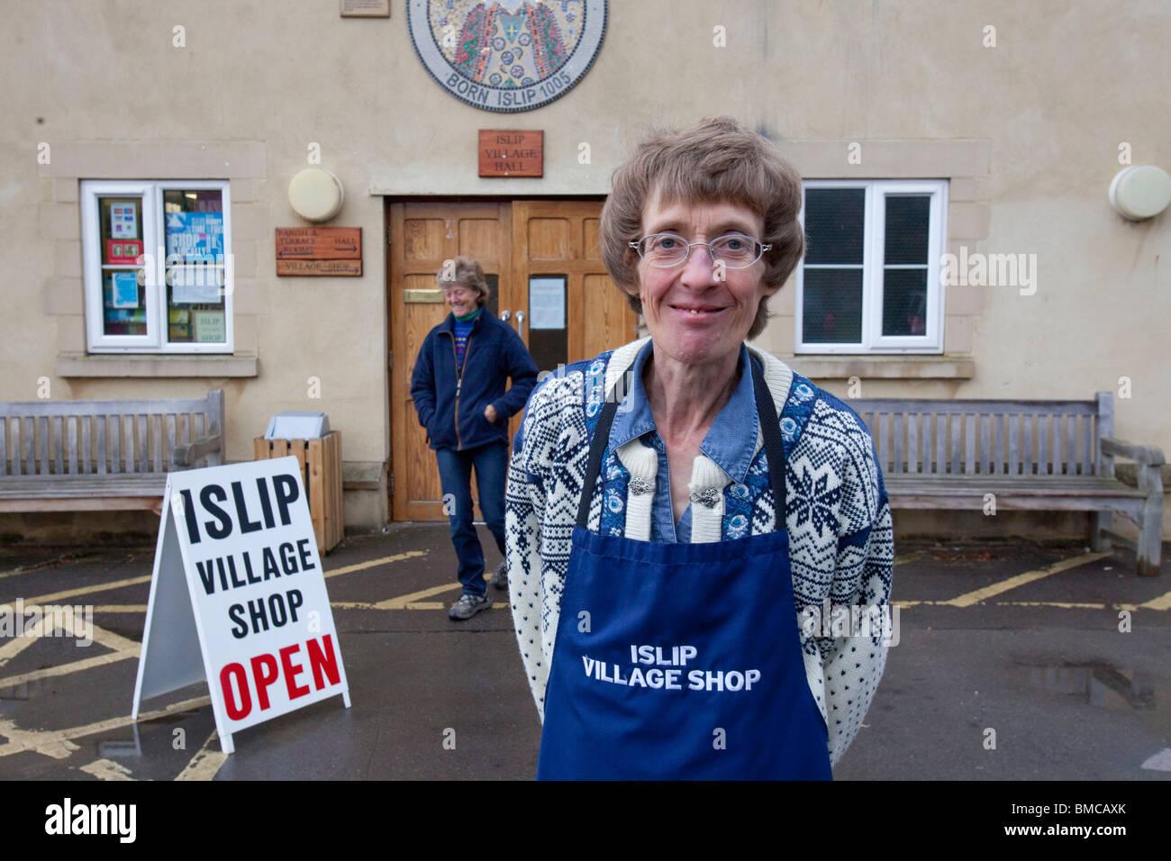Maralynn Smith who runs Islip Village shop based in the Islip Village hall, Oxfordshire - Stock Image