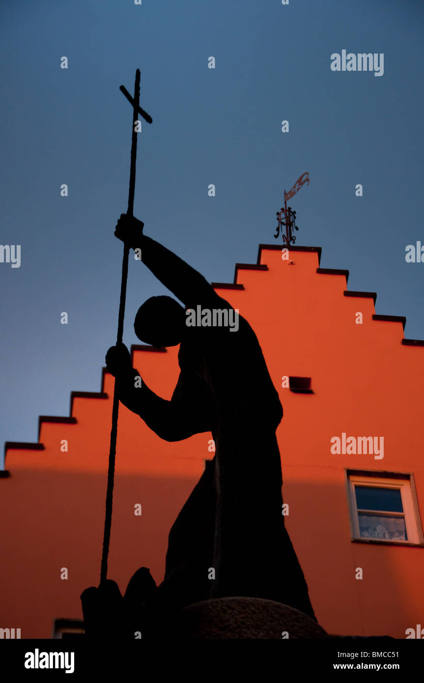 Silhouette of a religious statue at Fussen in the Romantic road, Bavaria, Germany - Stock Image