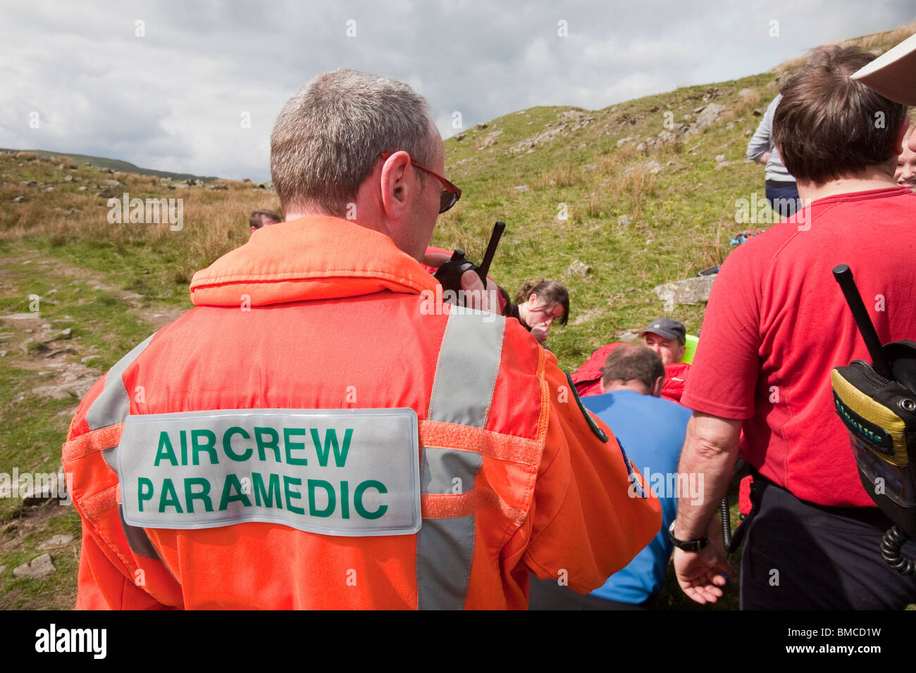 A man with a leg injury is stretchered by members of the Langdale/Ambleside Mountain Rescue Team, above Grasmere, - Stock Image