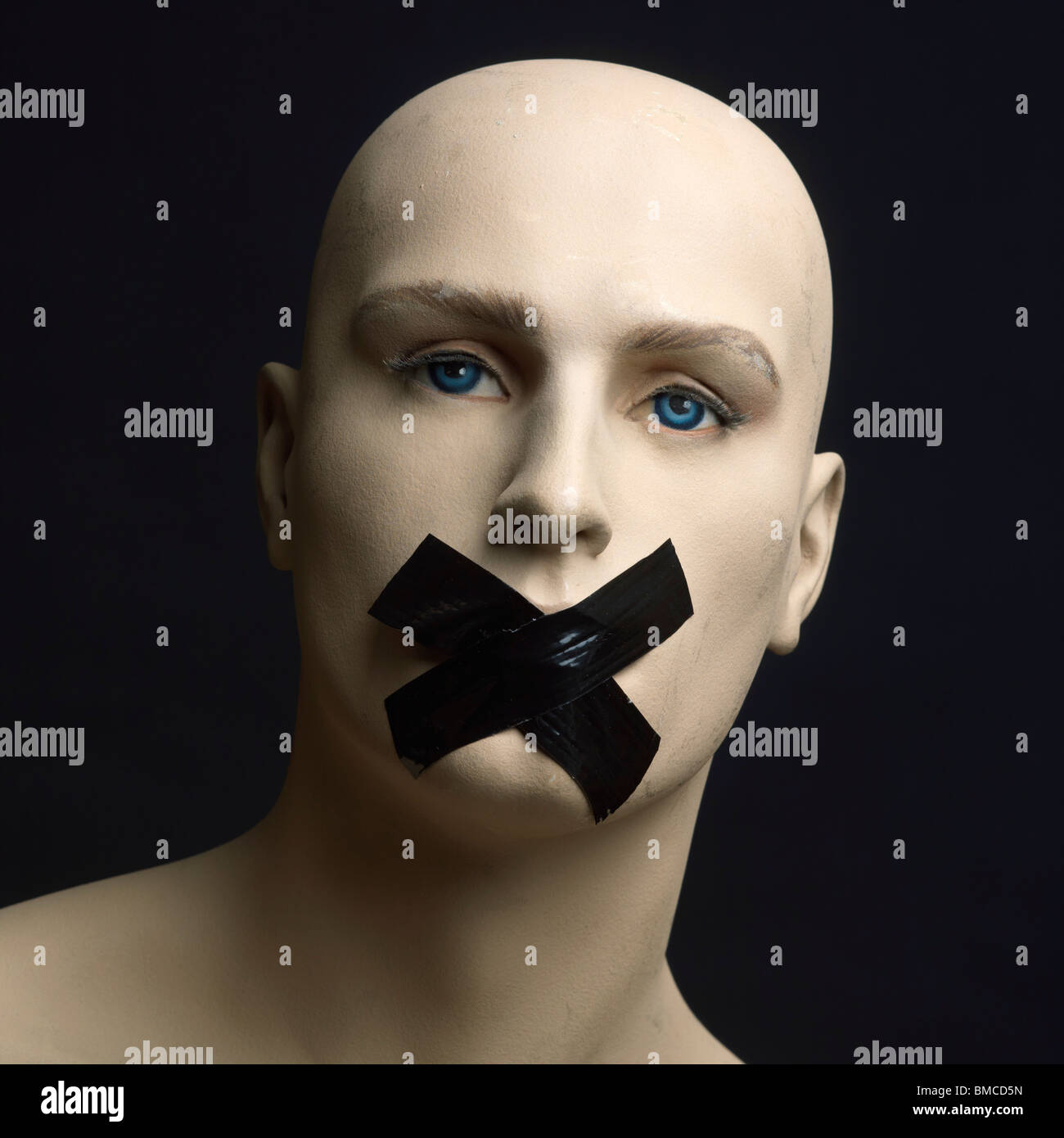 Dummy, mannequin, tape over mouth - censorship / secrecy / gagging / silence / free speech concept - Stock Image