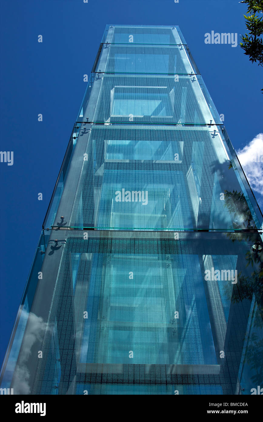 a glass tower reaches high up into the sky memorializing those killed during the nazi holocaust - Stock Image