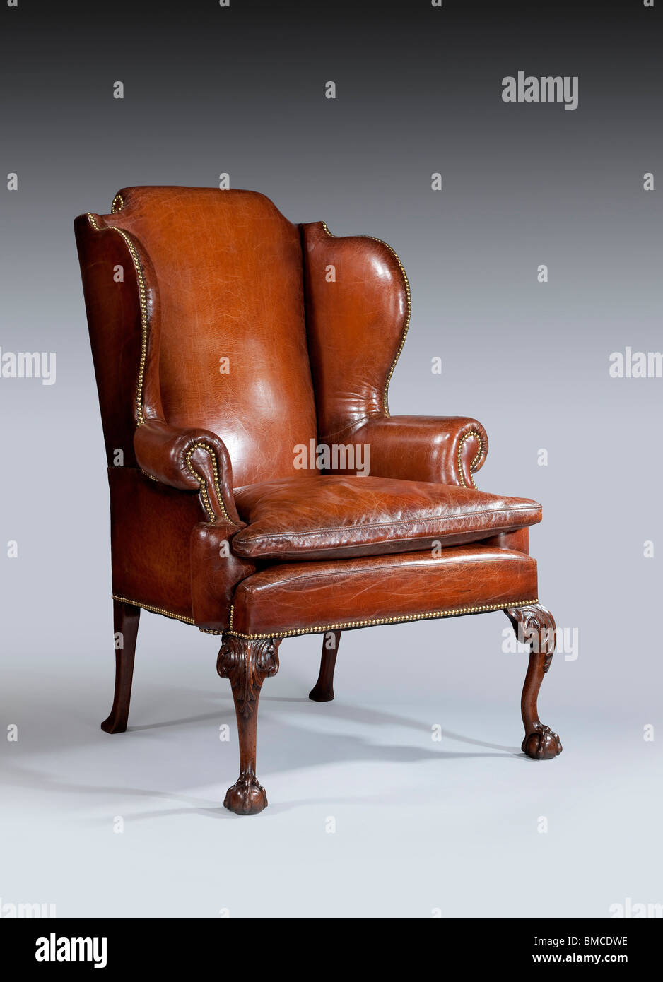 antique English leather wing chair with carved legs & antique English leather wing chair with carved legs Stock Photo ...