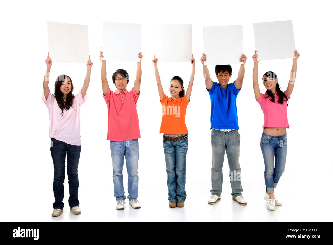 Group of people holding blank cardboards - Stock Image