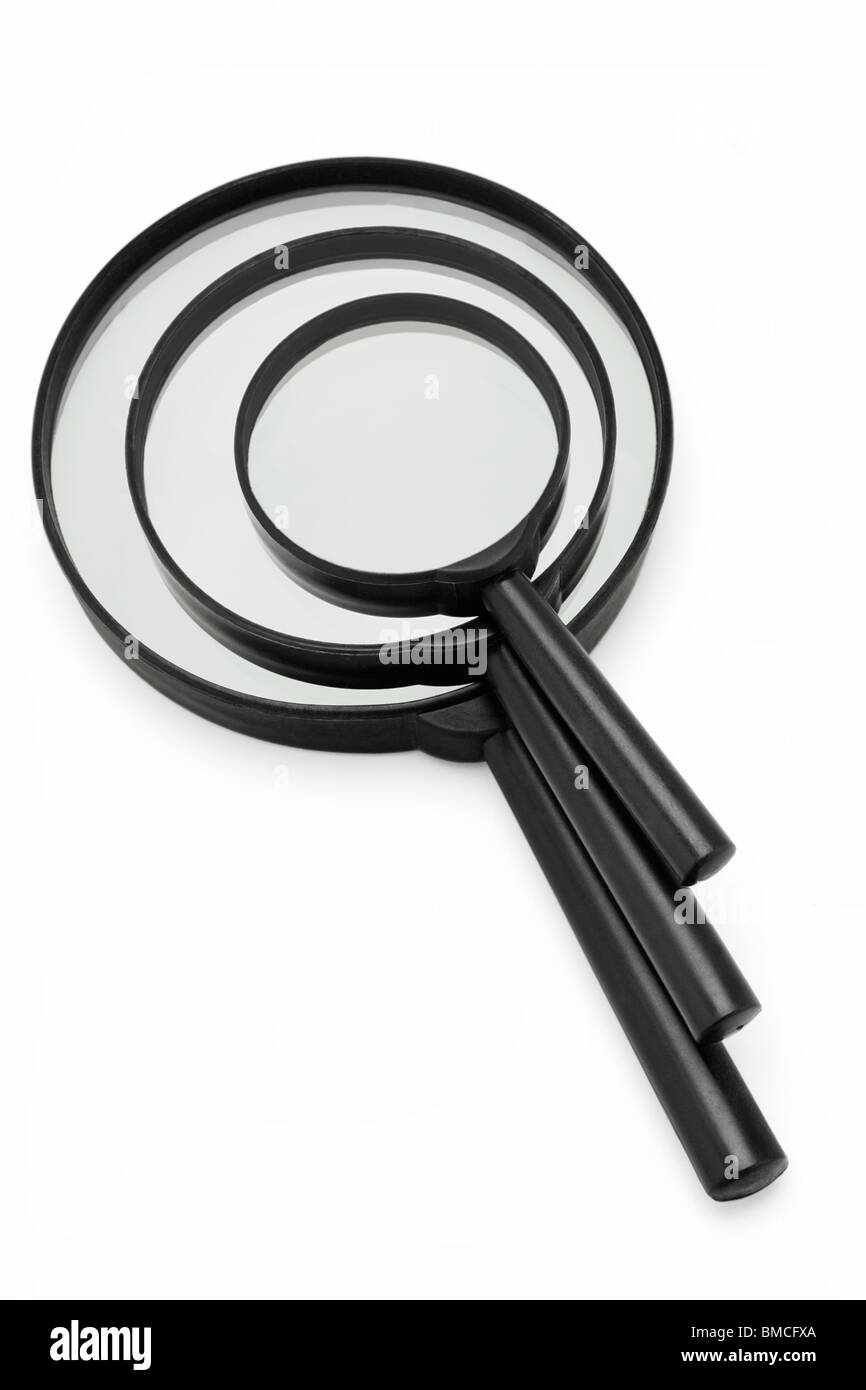 Stack of magnifying glasses in three different sizes - Stock Image