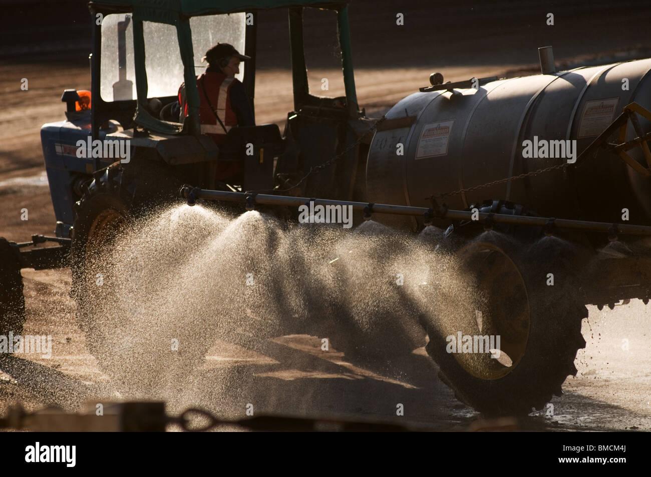 crop spraying sprayer spray pesticide pesticides fertilizer fertilizers field crops being sprayed sprays tractor - Stock Image
