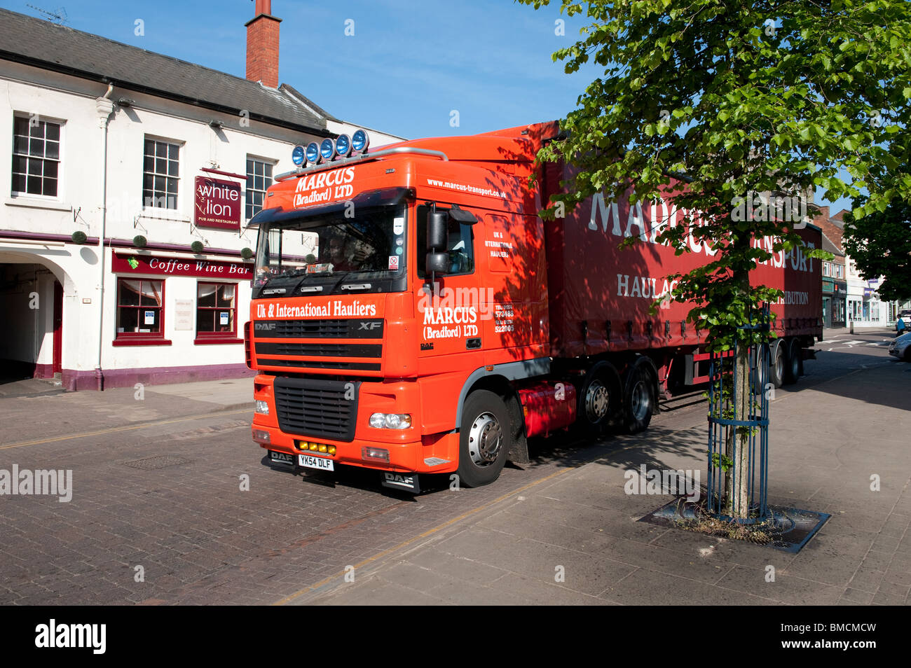DAF HGV lorry driving through the small market town of Market Harborough, England. - Stock Image