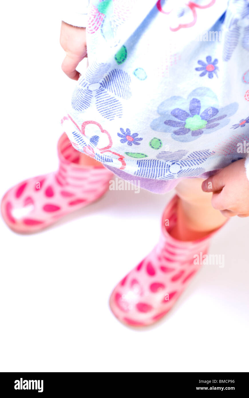 child wearing pink welly boots Stock Photo
