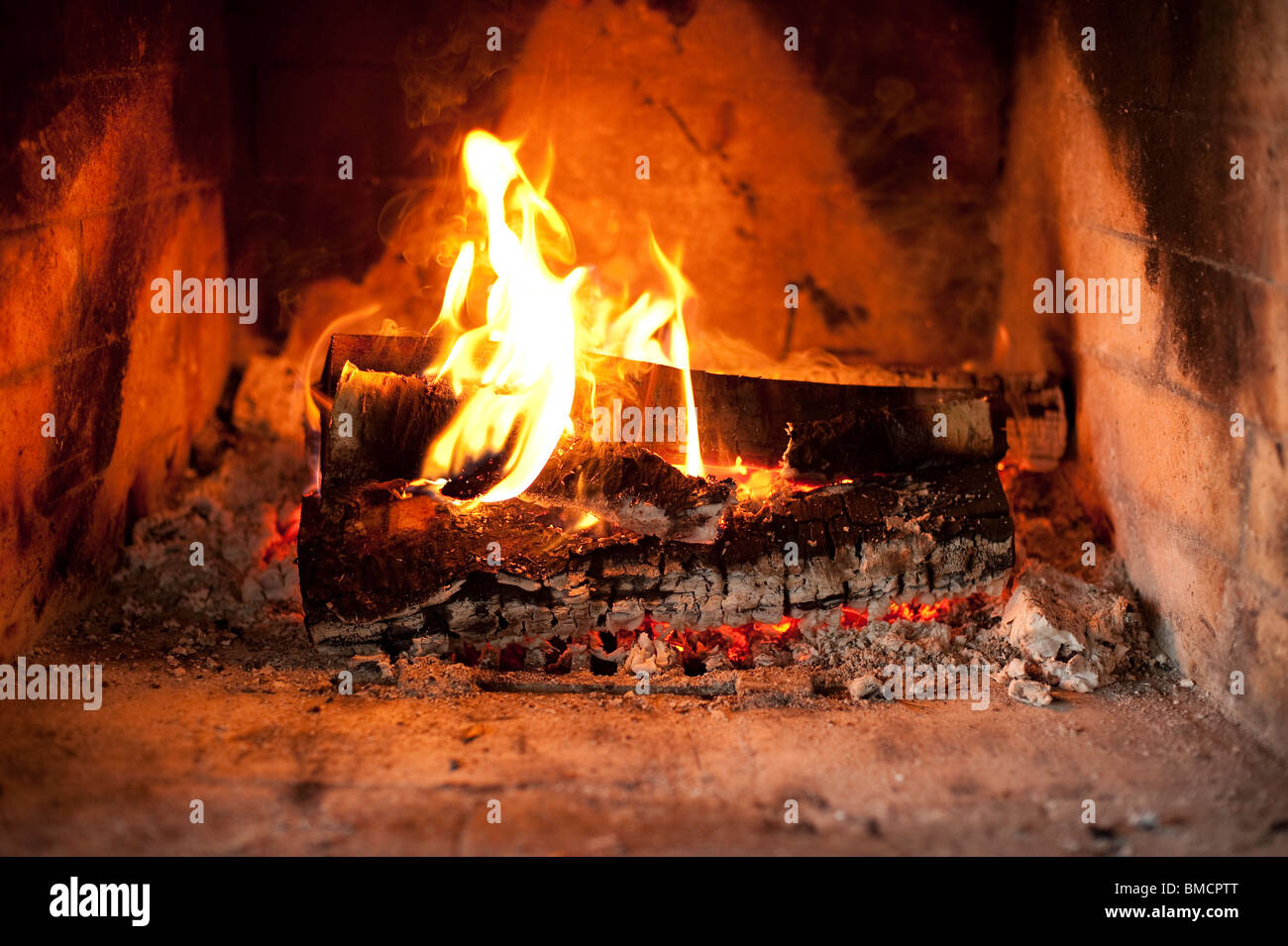 Fireplace with burning logs - Stock Image