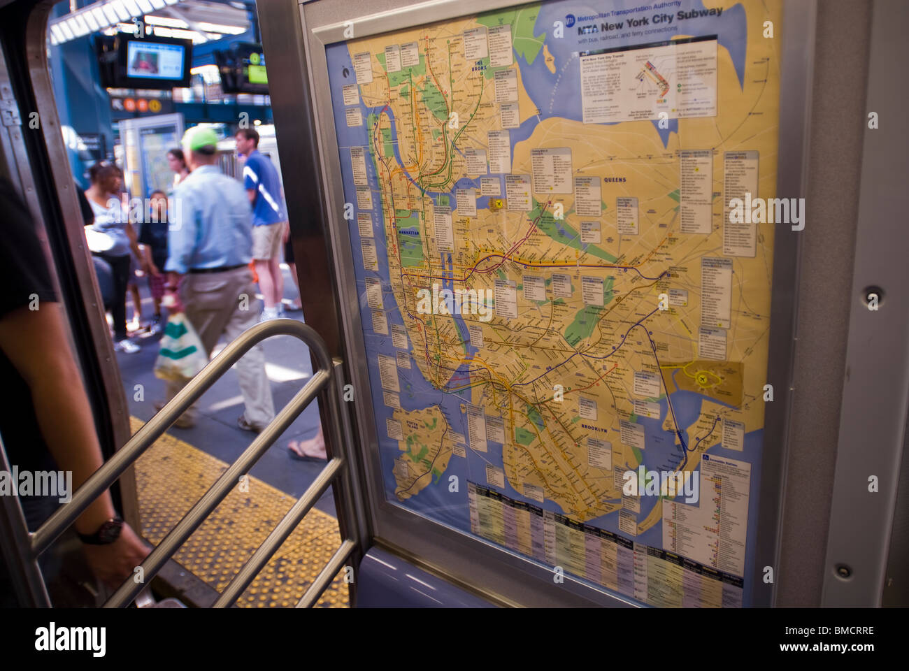 Train Subway Map New York.Passengers Pass A Subway Map As They Board A Q Train In Brooklyn In