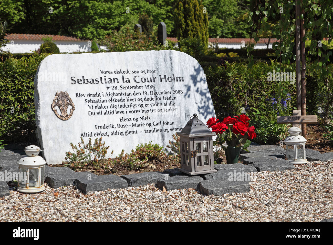 Grave of young Danish soldier fallen in action in Afghanistan at Karlebo Church cemetery, near Copenhagen, Denmark. - Stock Image