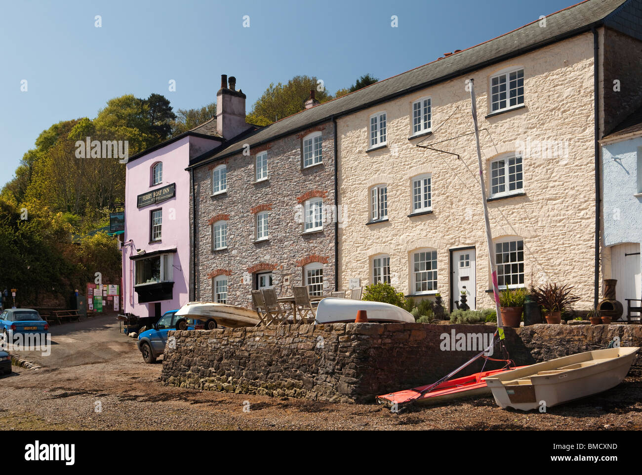 UK, England, Devon, Dittisham, Ferry Boat Inn colourfully painted riverside, houses on the Quay - Stock Image