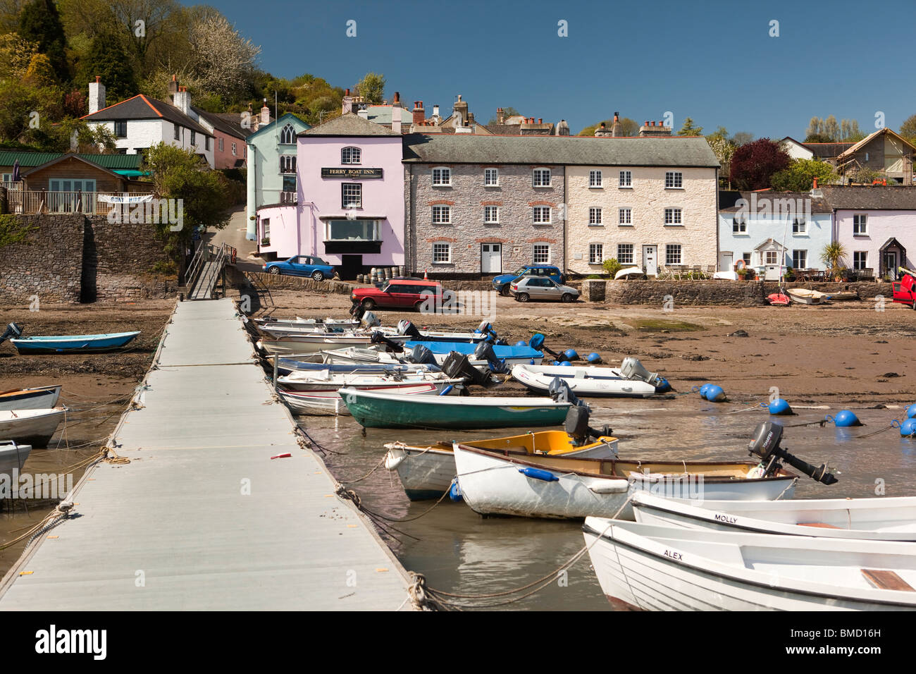 UK, England, Devon, Dittisham, yacht tenders moored in front of colourfully painted riverside houses on the Quay Stock Photo