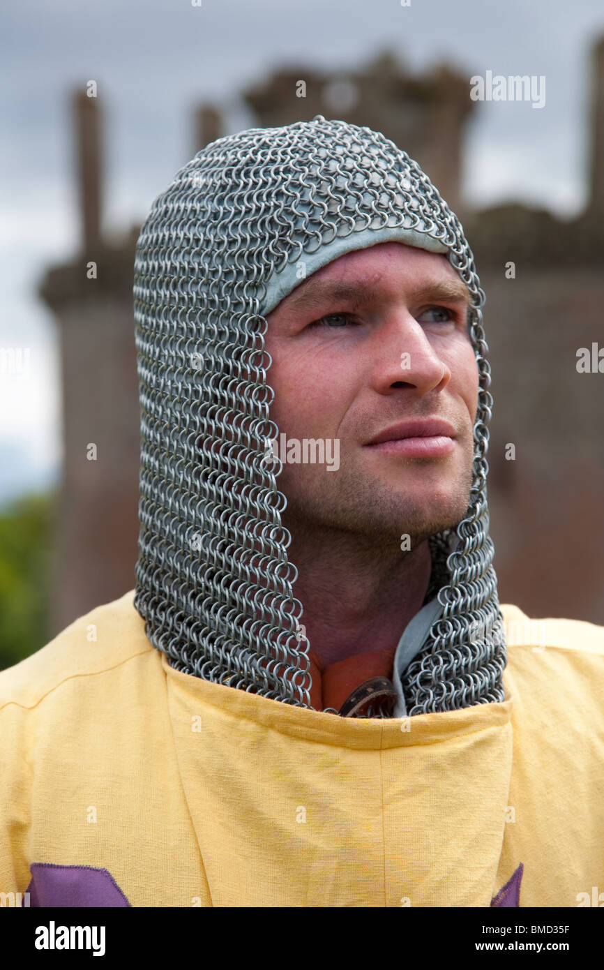 Head and Shoulders of Soldier wearing chain mail and tunics, Scotland at War, Caerlaverock Castle  UK - Stock Image