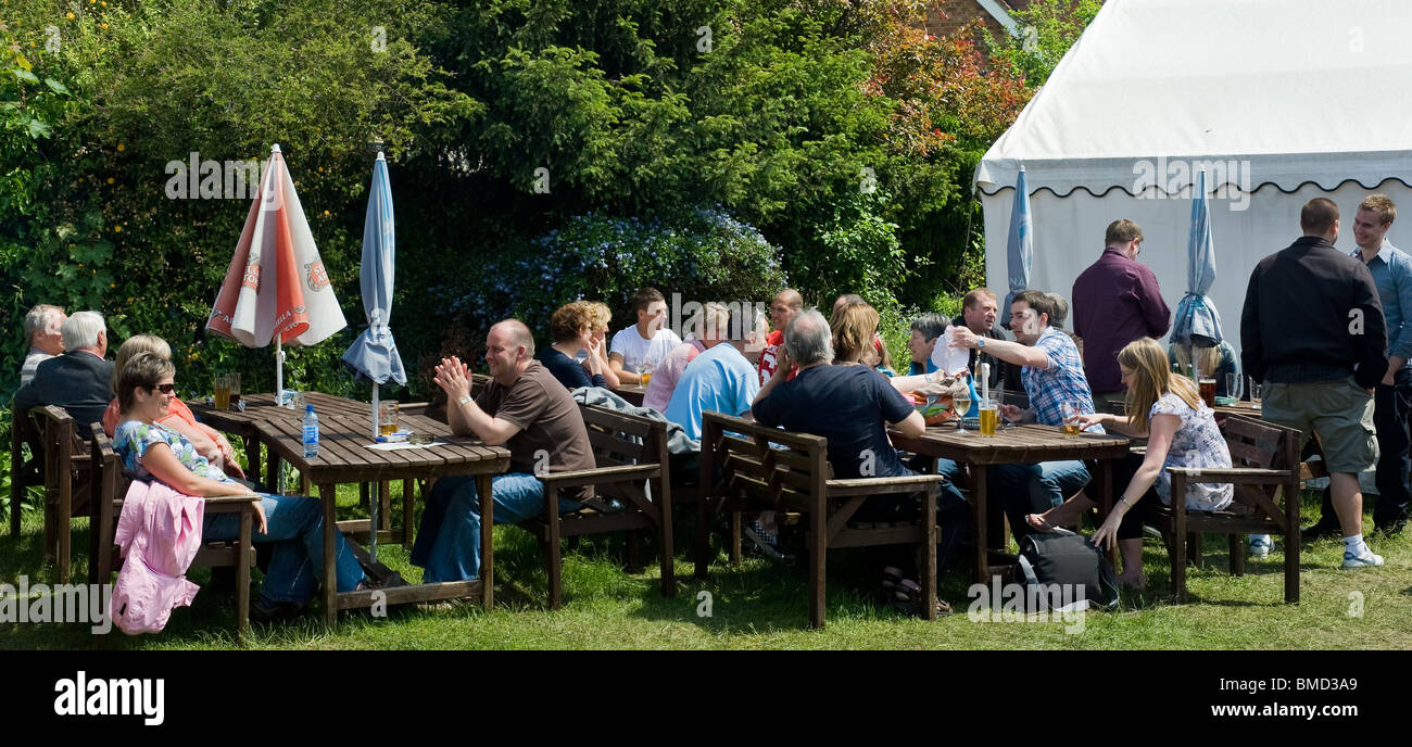 Customers sitting in the garden of the Hoop Public House in Stock in Essex.  Photo by Gordon Scammell - Stock Image