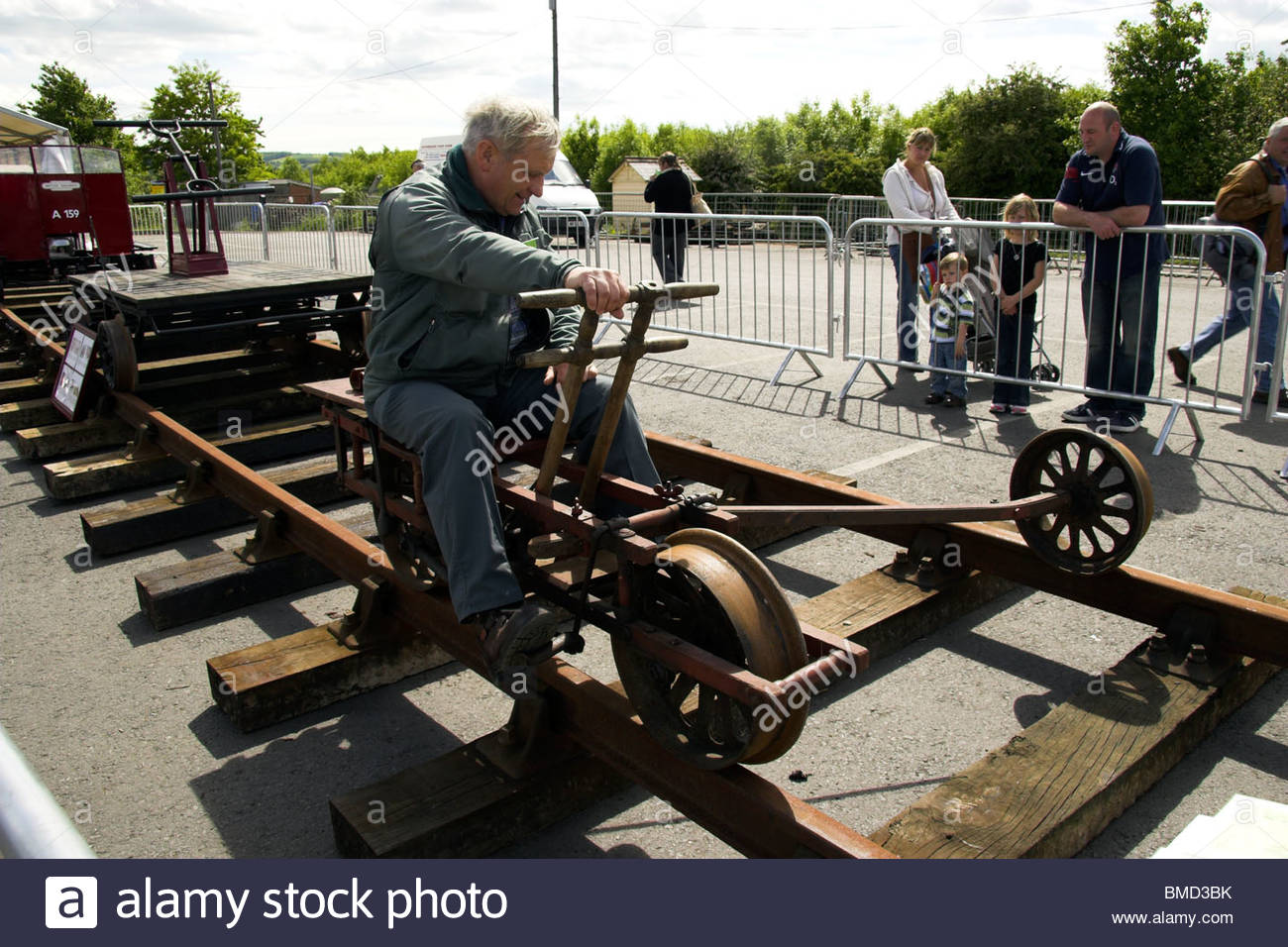 A man demonstrating the use of a railway velocipede at the Gloucestershire & Warwickshire Railway, Toddington, - Stock Image