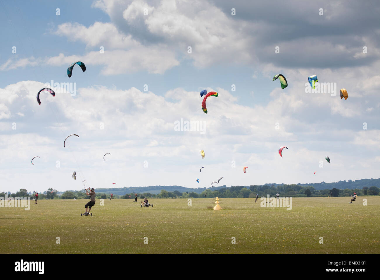 Middle Wallop Kite festival 2010, Kite landboarding and buggying on airfield on summers day - Stock Image
