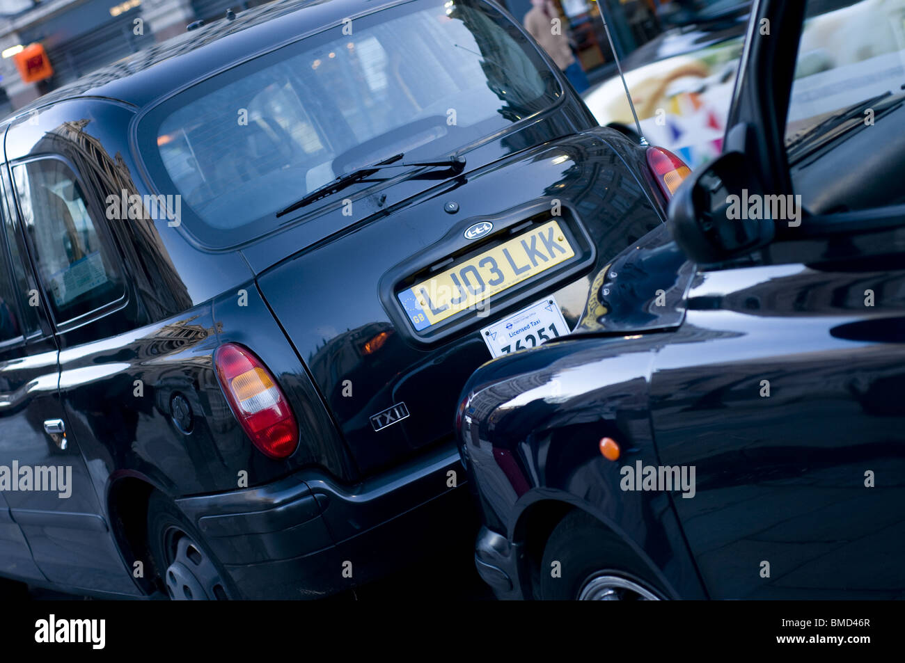 Crop of London Taxi Cabs bumper to bumper - Stock Image
