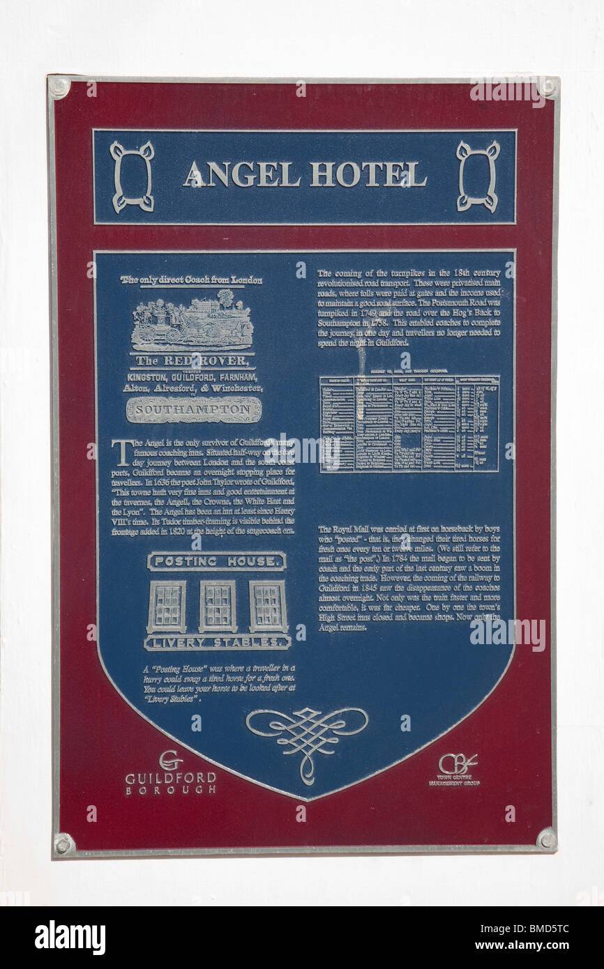 A wall plaque containing details about the the Angel Hotel, Guildford, Surrey, England. - Stock Image