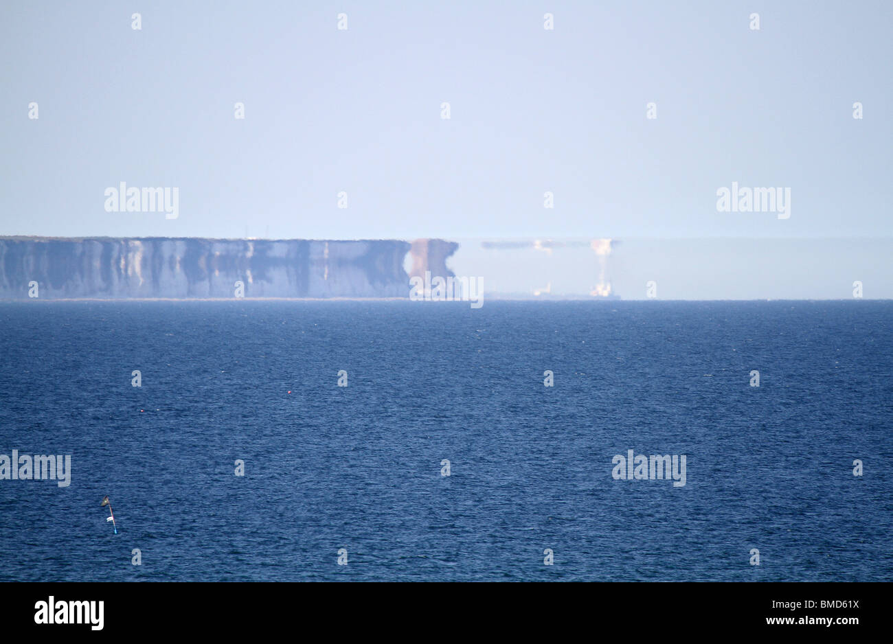 Mirage in hot weather in north sea off UK coast. - Stock Image