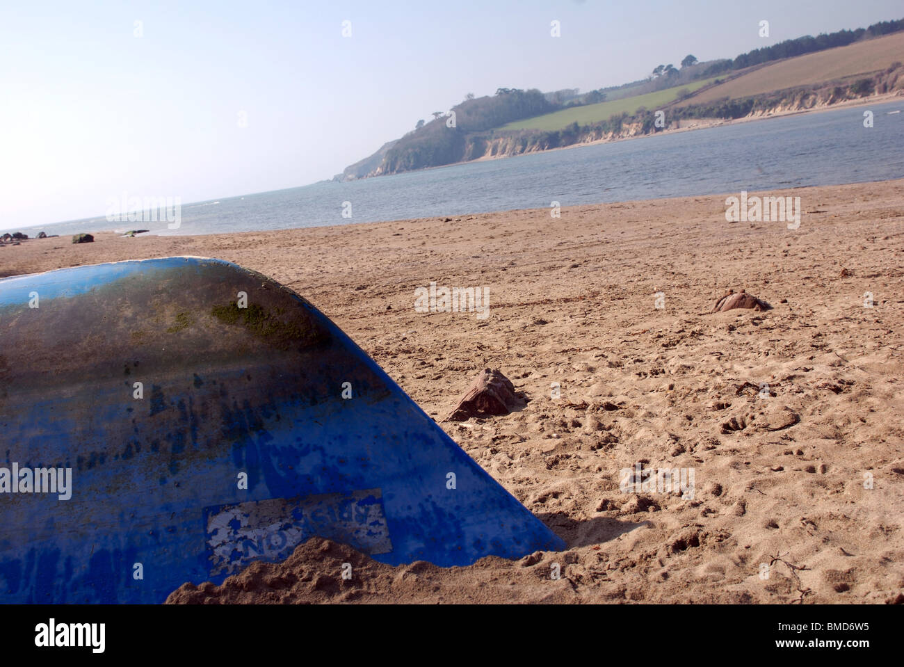 Bow of upturned boat at angle, Erme estuary, near Kingston, South Hams, Devon, UK - Stock Image