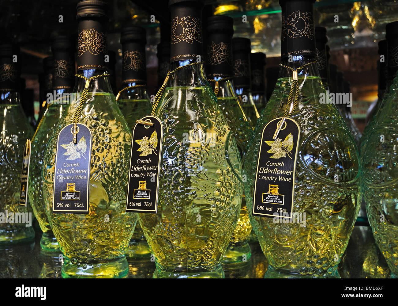 bottles of cornish fruit wine for sale in a farm shop near truro,cornwall,uk - Stock Image