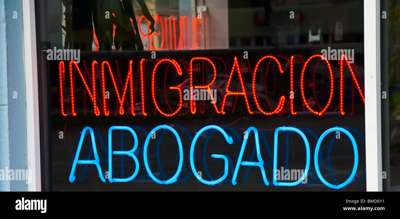 Immigration attorney sign in Spanish in window, Miami Beach, Florida, USA - Stock Image