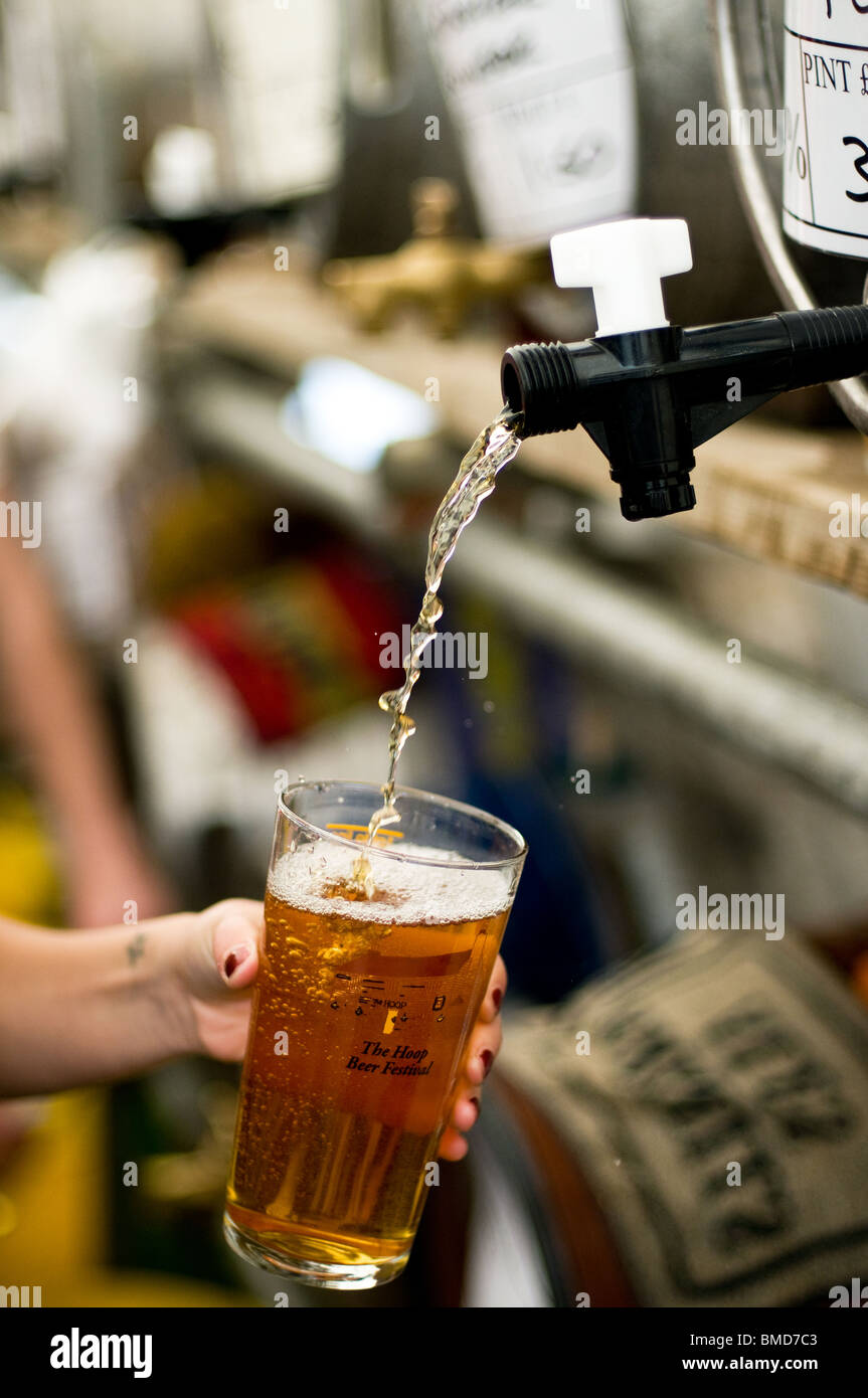 A pint of real ale being poured at the Hoop Pub Beer Festival in Stock in Essex. - Stock Image