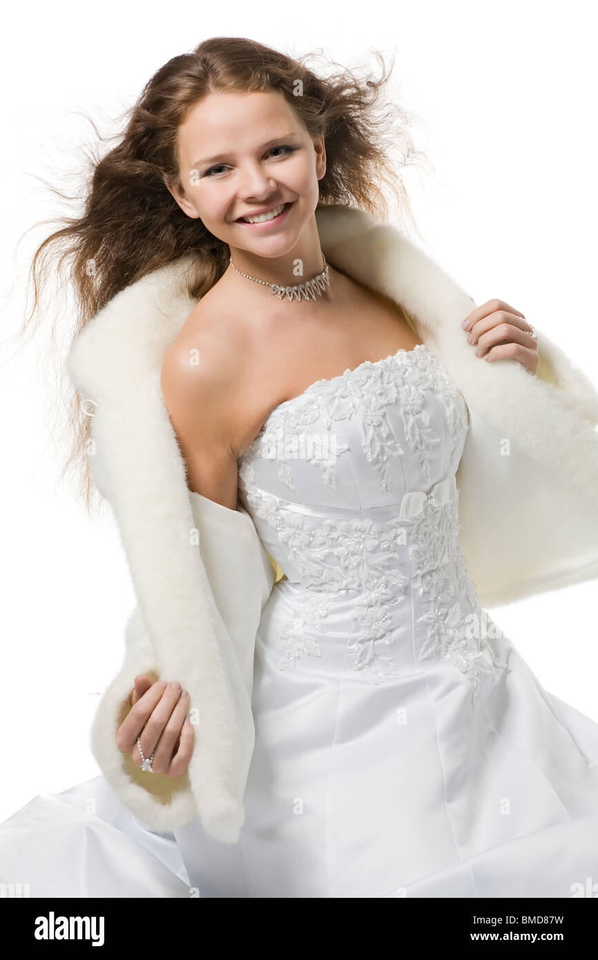 Beautiful Smiling Bride With Flying Hair In A Wedding Dress And A