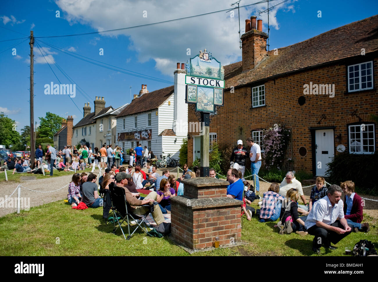 Crowds of people outside the Hoop Public House in the village of Stock in Essex.  Photo by Gordon Scammell - Stock Image