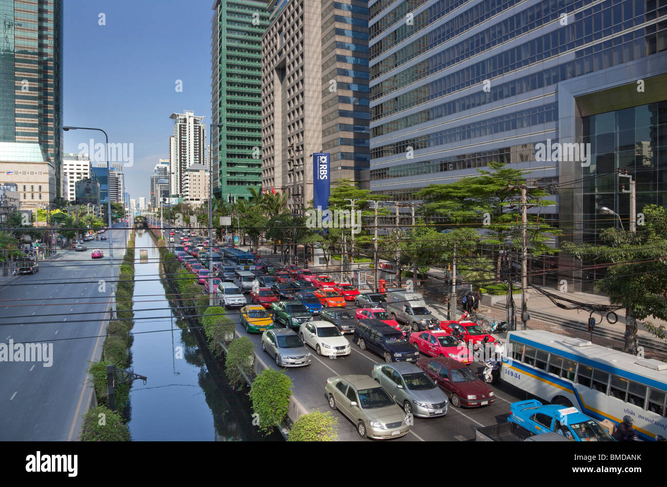 Sathon Road in central Bangkok. Mid afternoon traffic is queuing on the westbound side. Stock Photo