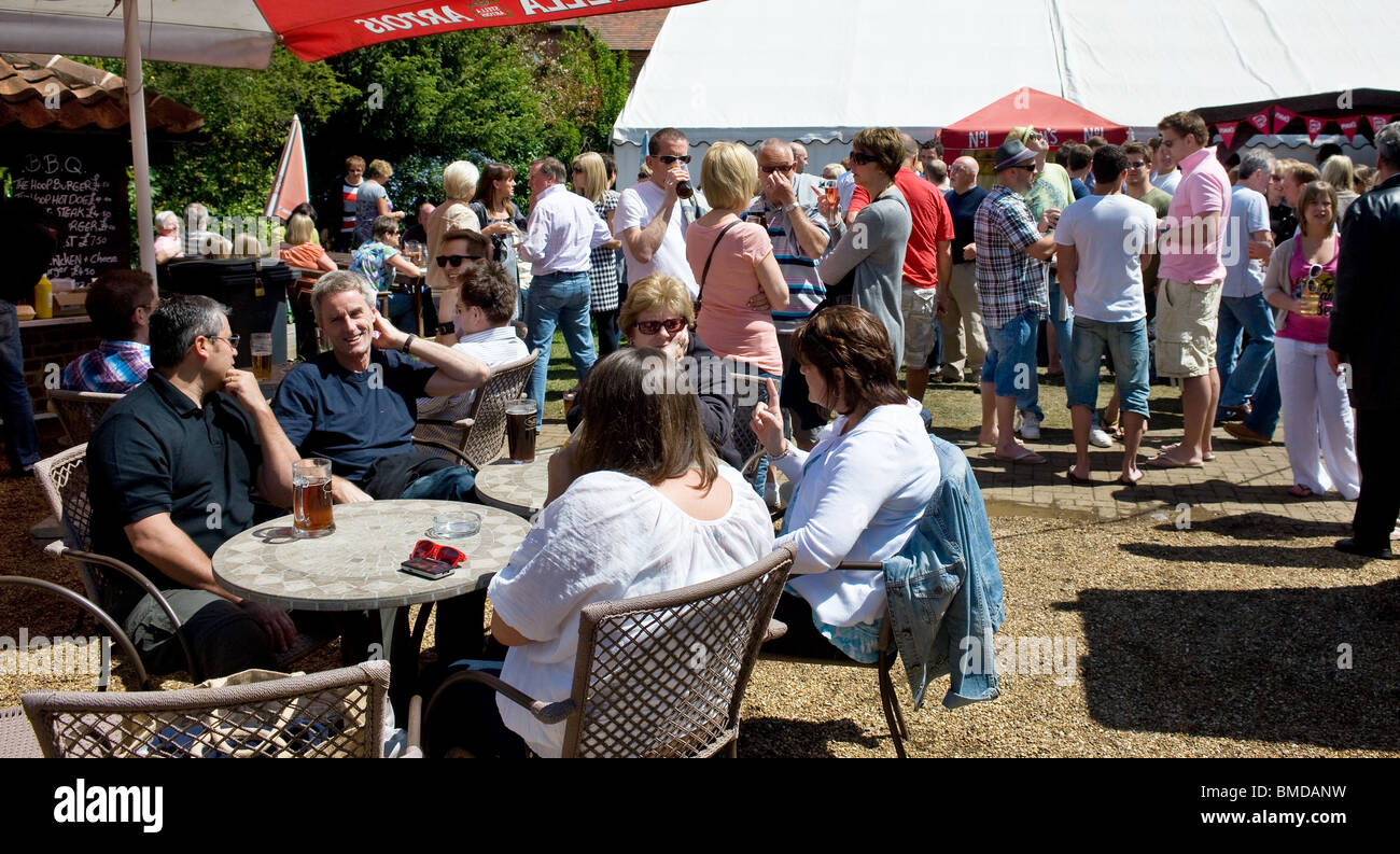 People in the garden of the Hoop Pub in Stock in Essex.  Photo by Gordon Scammell - Stock Image