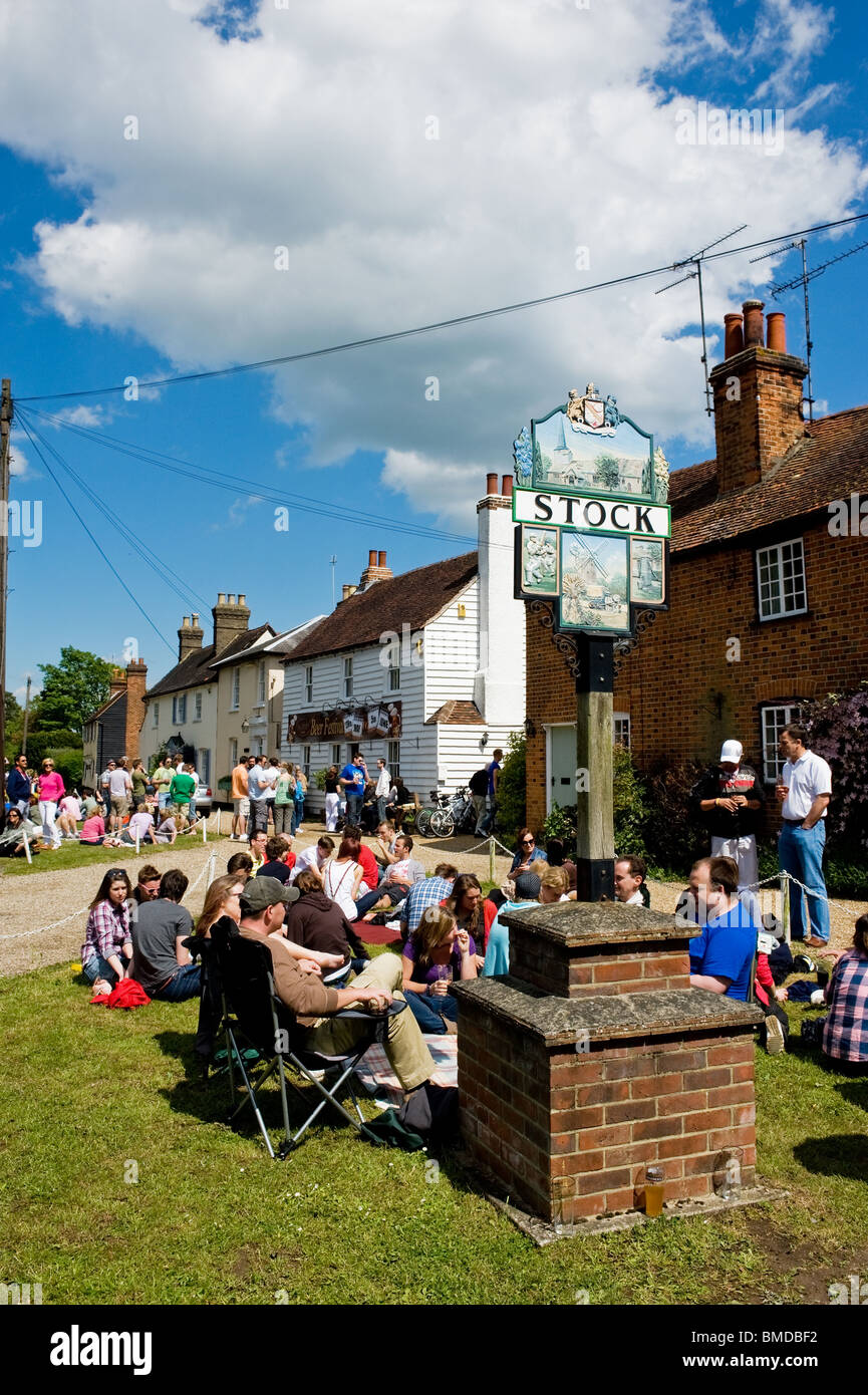 People sitting outside the Hoop Public House in the village of Stock in Essex.  Photo by Gordon Scammell - Stock Image