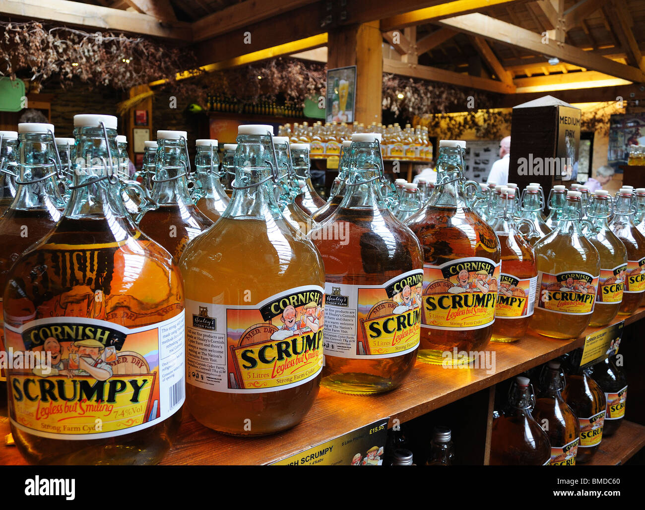flagons of cornish scrumpy cider for sale in a farm shop near truro,cornwall,uk - Stock Image