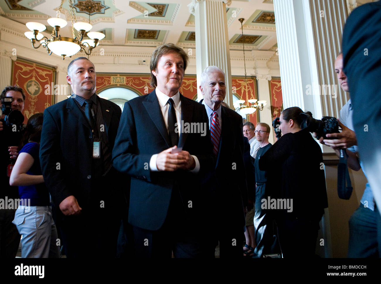 Paul McCartney takes questions at a press conference. - Stock Image