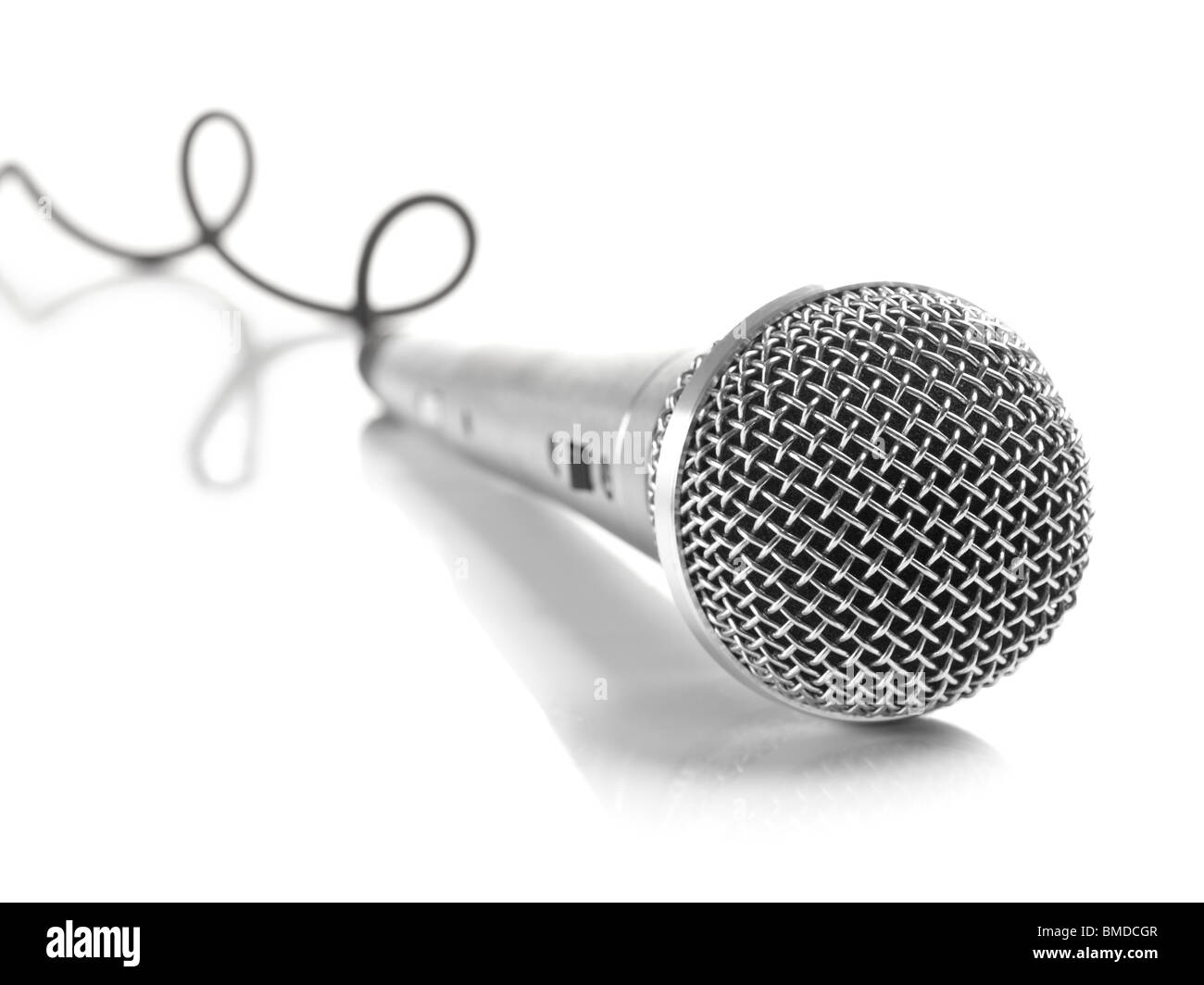 A dynamic mic with a curled cable over white. - Stock Image